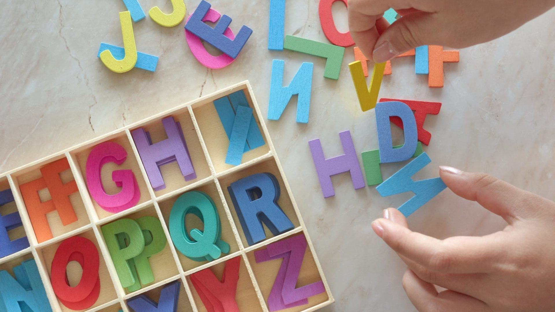 Child play the colorful wooden alphabet toy